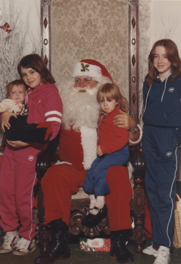 My lovely sisters (and me, the cute blonde one). You gotta love an awkward Santa picture. And sisters in matching tracksuits.