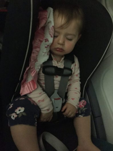 Shoshana asleep in her carseat on the flight to Ireland