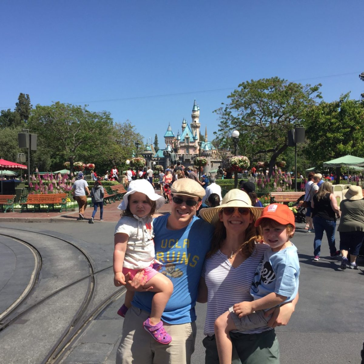 Disneyland castle family picture - it was so hard to get the kids focused on a camera when we had just walked into such a visual feast, but I think we succeeded!