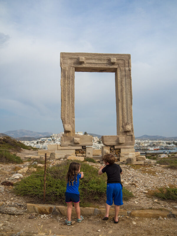 There are so many things to do on Naxos with kids, including checking out the ancient Portara. #Naxos #Greece