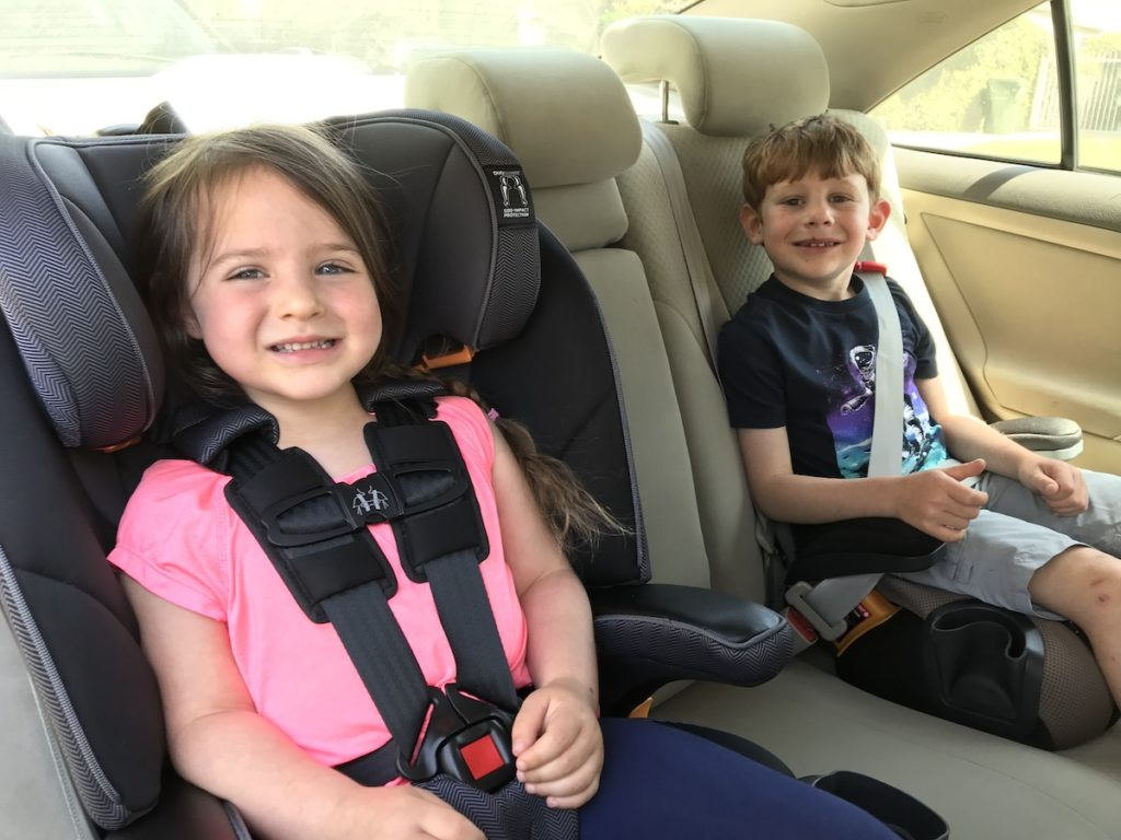 Looking for the most comfortable booster seat for long drives? This guide has all the best comfy booster seats - even reclining booster seat options like this Chicco MyFit!
