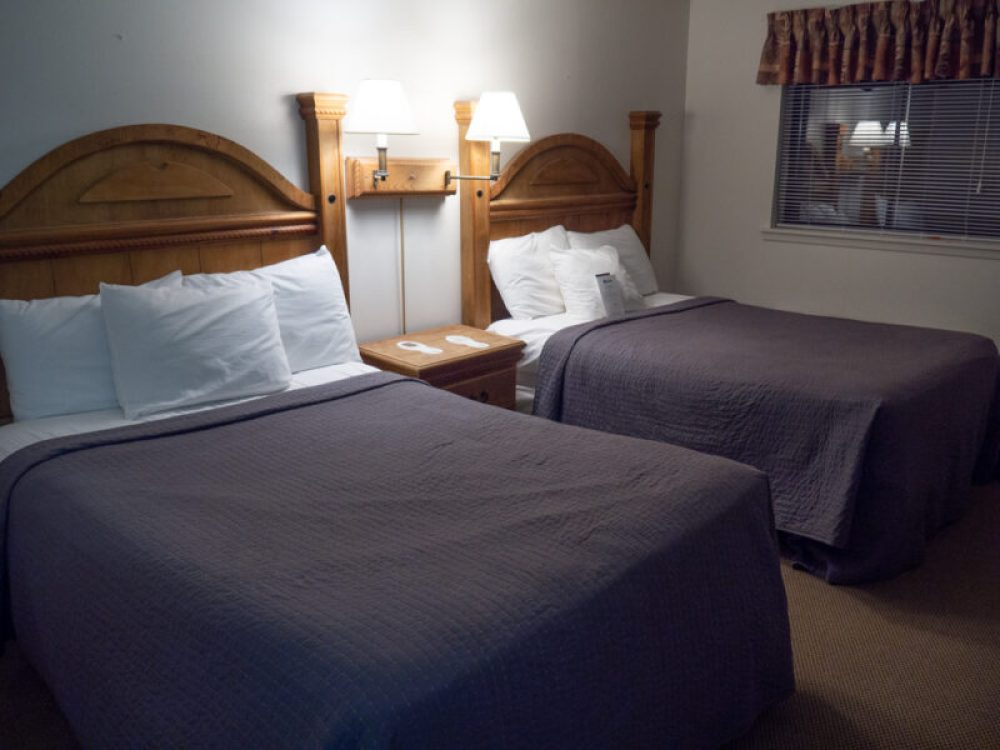 Casa Grande room at Chisos Mountain Lodge showing two beds with lamps in between