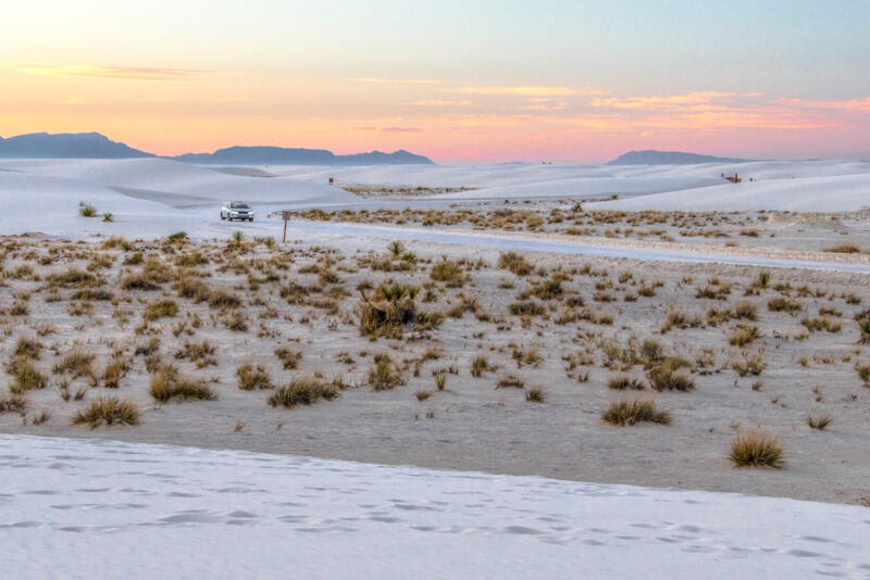 Sunset at White Sands National Park, white dunes in foreground and pink sunset in background