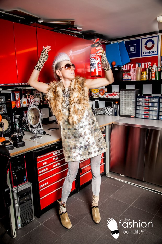 The Fashion Bandits Benedikte St.Pierre is spraying her hair with a fire extinguisher
