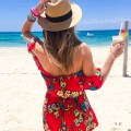 Off-the-shoulder Tropical Red Romper on the beach