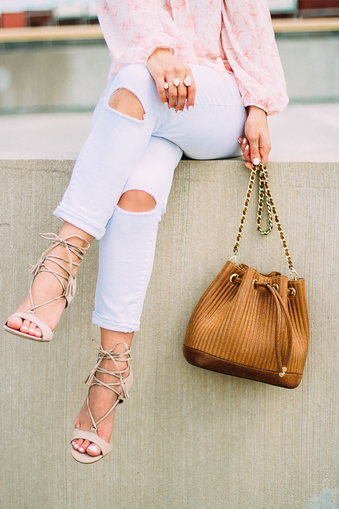 Ripped white jeans henri bendel bucket bag