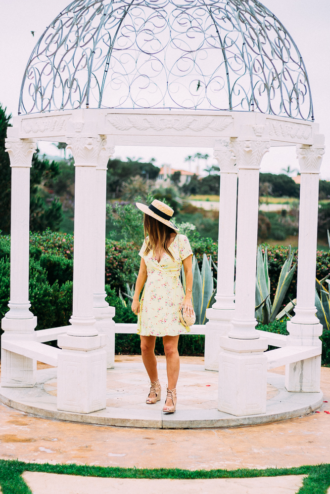 floral yellow wrap dress in botanical gardens