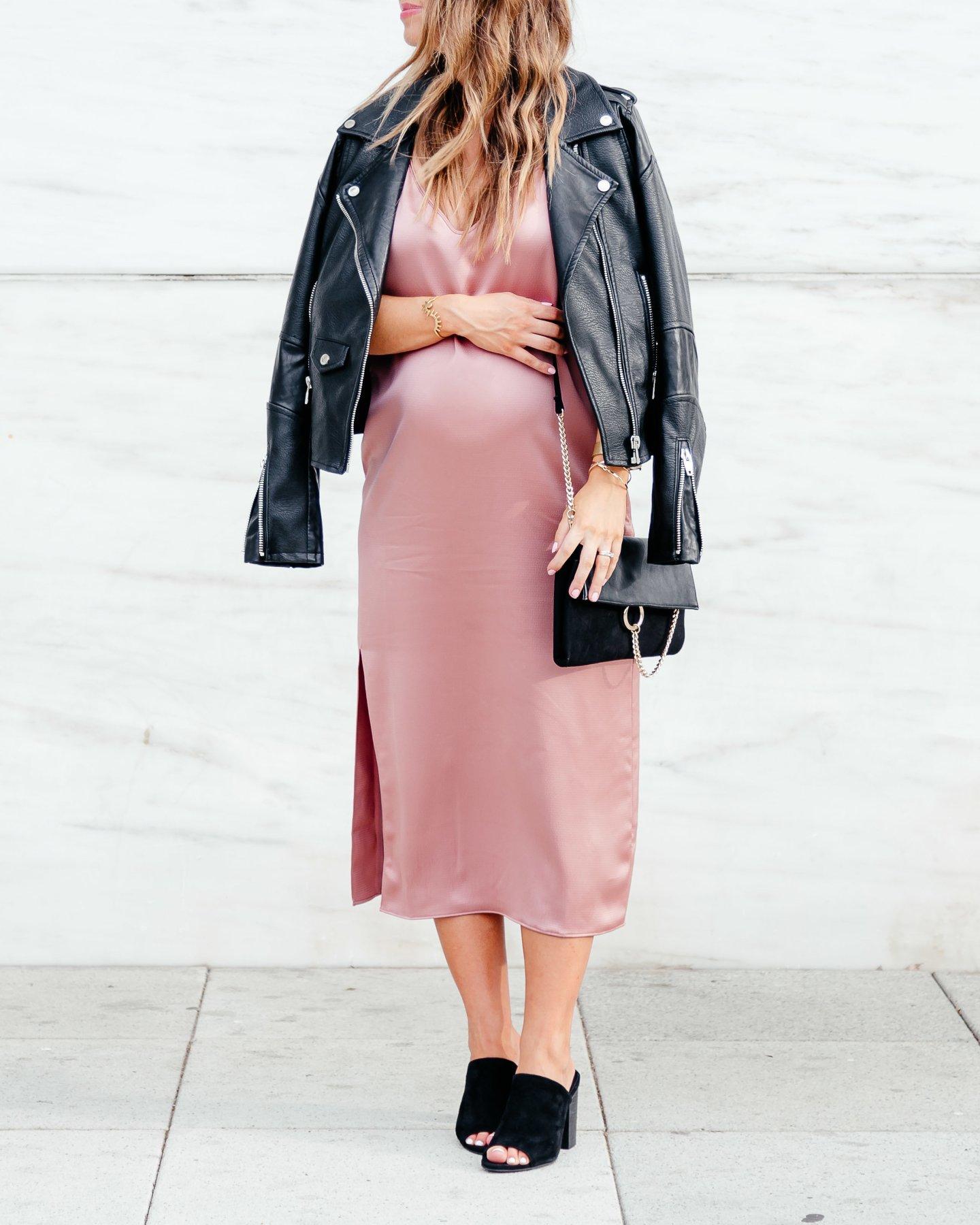 pink slip dress with black moto jacket