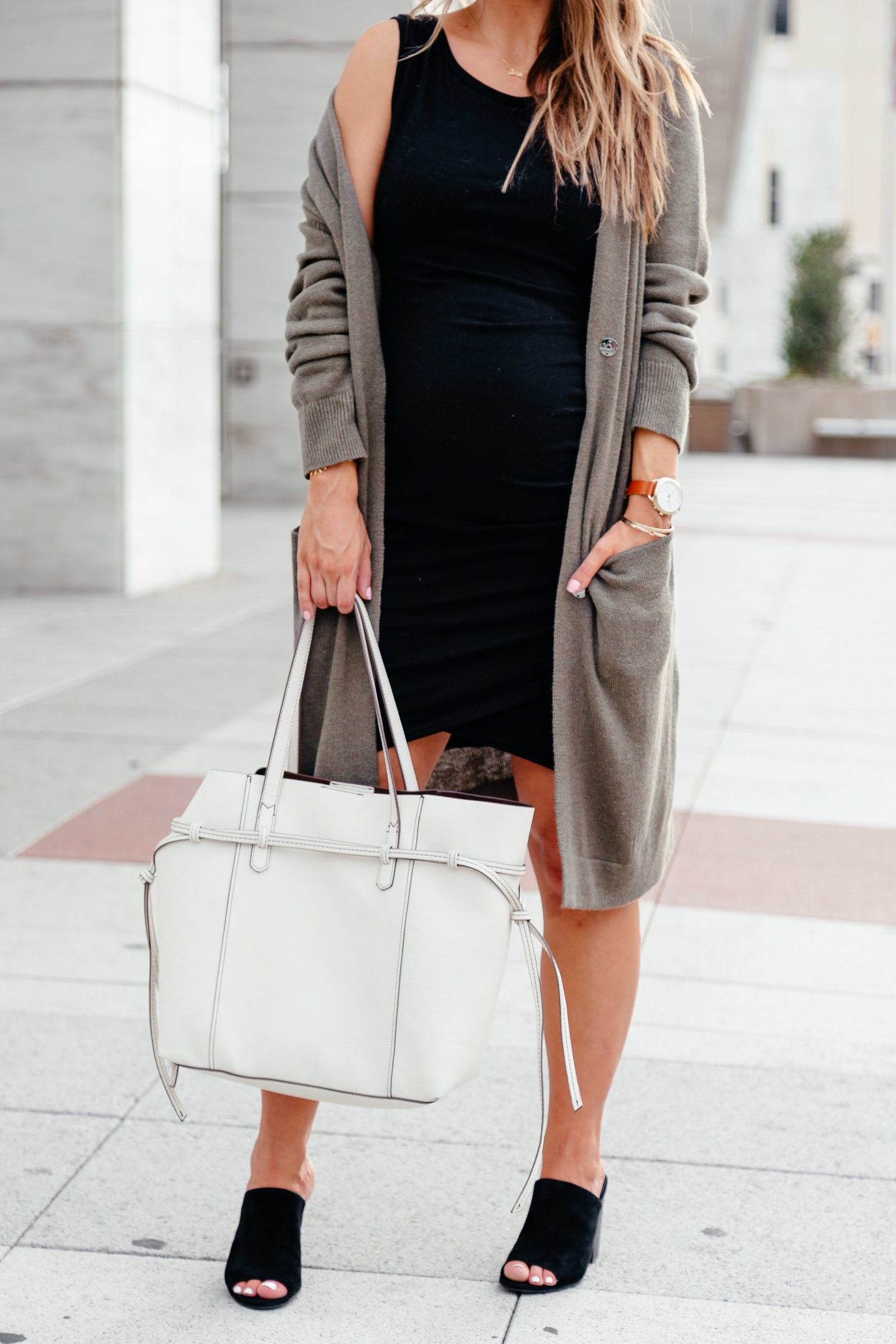 black bodycon dress with black mules and cardigan