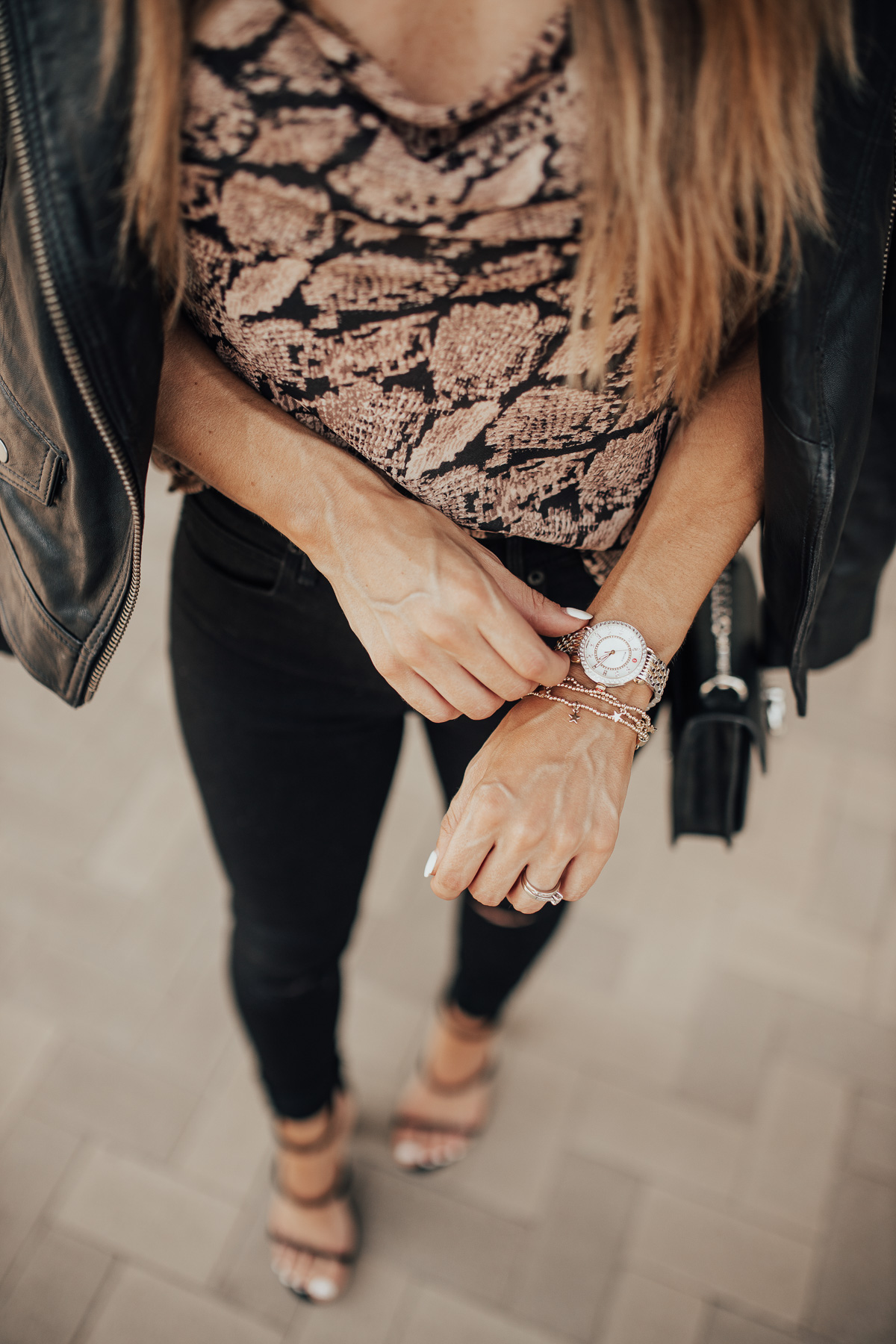 BLACK LEATHER JACKET WITH SNAKE PRINT CAMI AND JEANS AND MICHELE WATCH