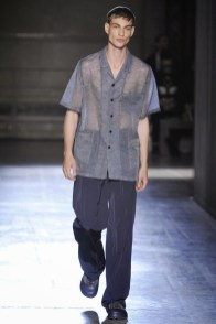 Johannes Linder walks for Wooyoungmi during Paris Fashion Week.