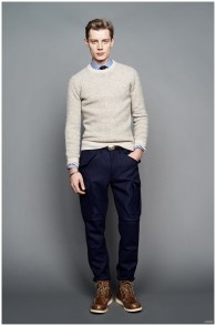 Smart Casual: All hail the sweater when it comes to dressing professional for a situation that doesn't call for a tailored suit. Here, J.Crew perfectly layered a crewneck sweater with a slim-fit dress shirt and tie. While the cargo pants and boots provide an interesting change of pace, a more traditional course of action would include chinos and oxford shoes.
