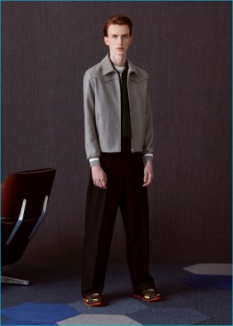 Matthew wears felt Harrington jacket, striped bowling shirt, wide-leg trousers, and runner sneakers Lanvin.