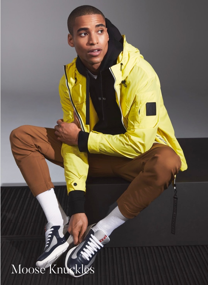 Front and center, Malik Lindo wears a yellow windbreaker by Moose Knuckles.