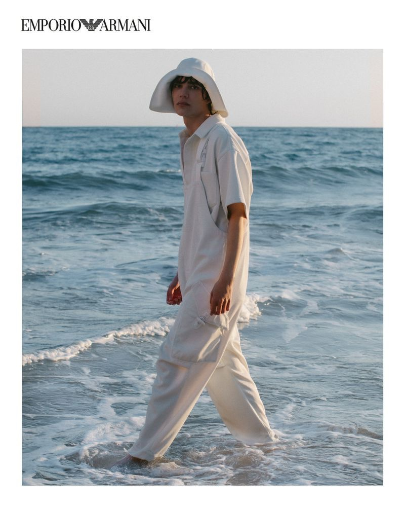 Hernan Cano sports overalls and a safari hat from Emporio Armani's spring-summer 2021 sustainable capsule collection.