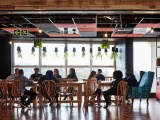 sustainability crowd, sitting around table