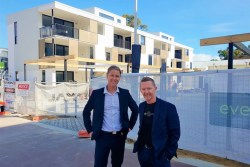 Yolk Property Group Director Tao Bourton and Power Ledger Co-founder David Martin on site at Evermore
