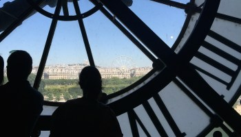 Tourists near the huge clocks in paris