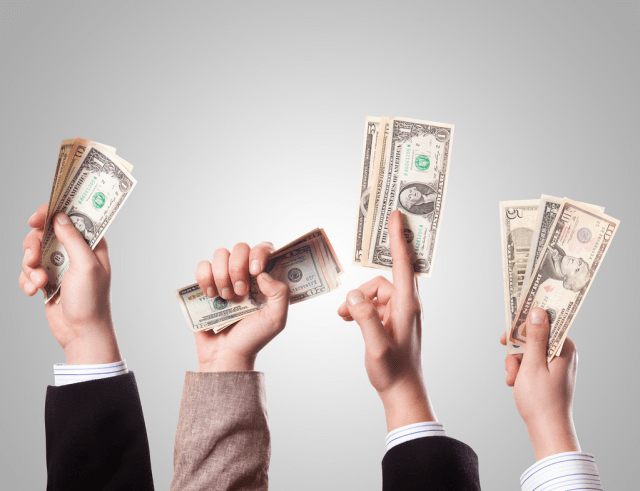 Avoiding Financial Mishaps With These Solid Tips - hands holding up dollars image
