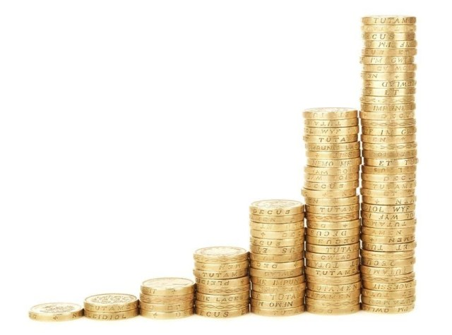 HELP! Who To Contact When Your Business Starts Showing Signs of Weakness - stacks of pound coins image