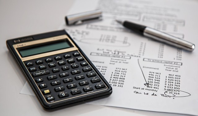 The Best Places To Invest Your Money - calculator and bills image