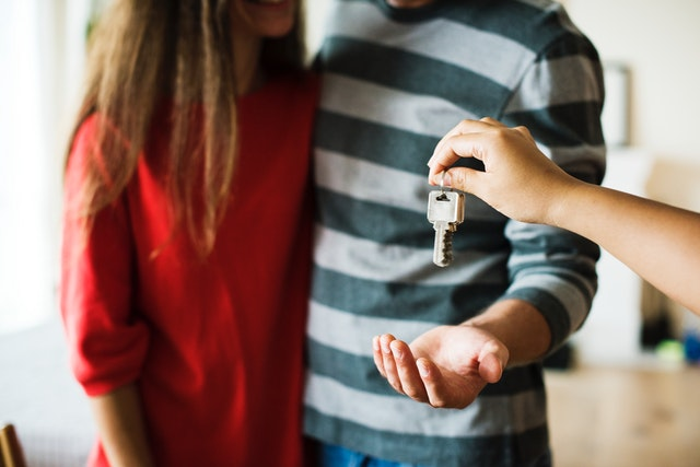 Getting The Most For Your Money In Property - couple receiving the keys to their home image