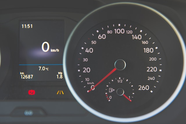 How to purchase your first vehicle - Leave The Costs Behind You On The Road -closeup of car dashboard