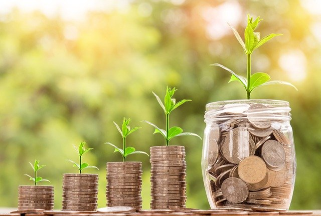 Grow your Funds with these Tips - The Financial Fairy Tales blog image of money growing in a jar