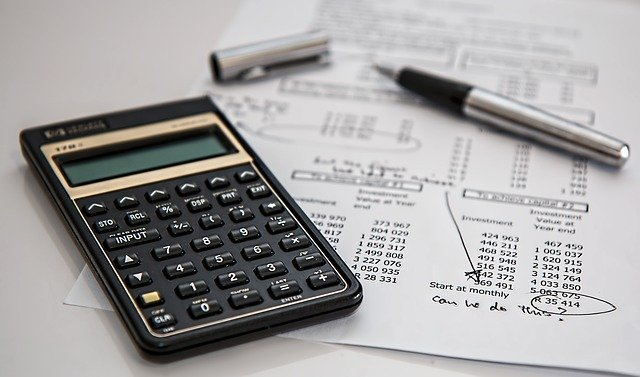 5 Smart Financial Practices That Can Improve Your Business - calculator and finances image