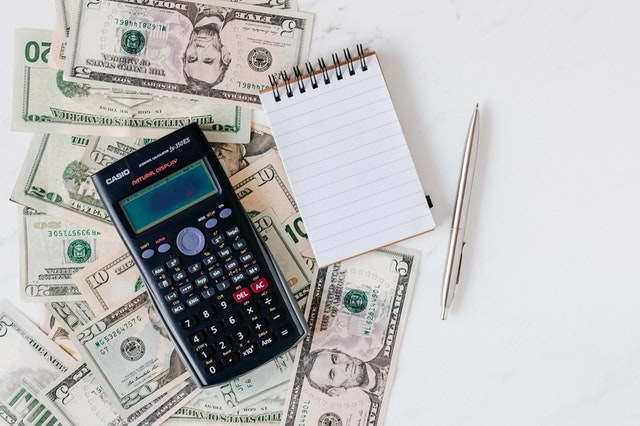 4 Reasons Why Managing Your Finances Is a Must - calculator and money image