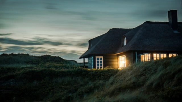 Considerations When Choosing the Right Property - house lit at dusk image