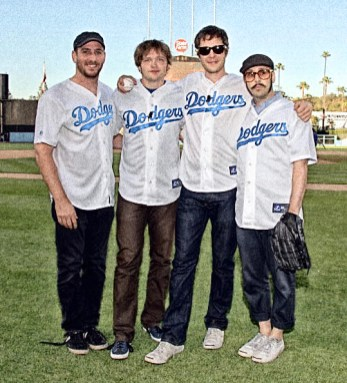 LOS ANGELES, CA - MAY 20: (L-R) Musicians OK Go Dan Konopka, Andy Ross, Damian Kulash and Tim Nordwind pose before throwing the ceremonial first pitch prior to the game between the Los Angeles Dodgers and the San Diego Padres at Dodger Stadium on May 20, 2010 in Los Angeles, California. (Photo by Mark Sullivan/WireImage)