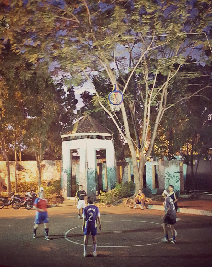 A ballgame we encountered in Trang: kind of like netball but no running around the court. Does anyone know what it is?!