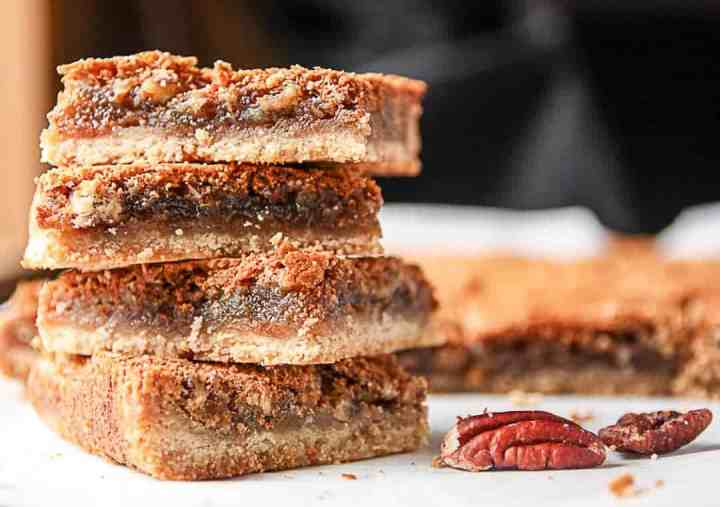 Four butter tart shortbread squares stacked