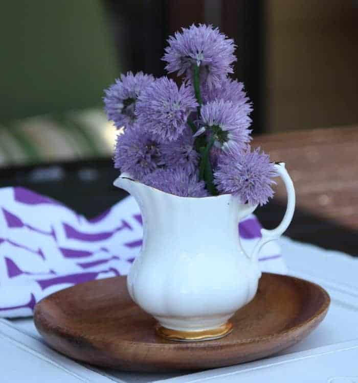 A vase filled with purple flowers on a table