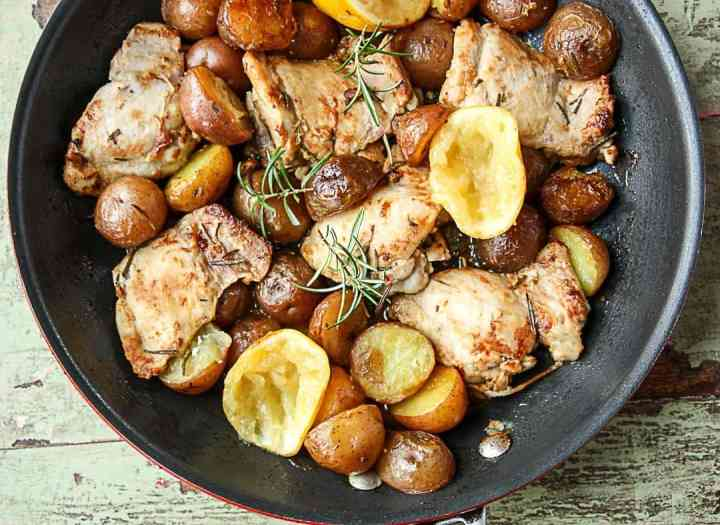A pan of food on a table, with Chicken Thighs
