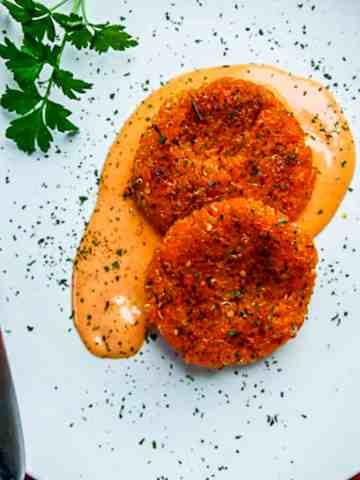 sweet potato quinoa cakes on a white plate.