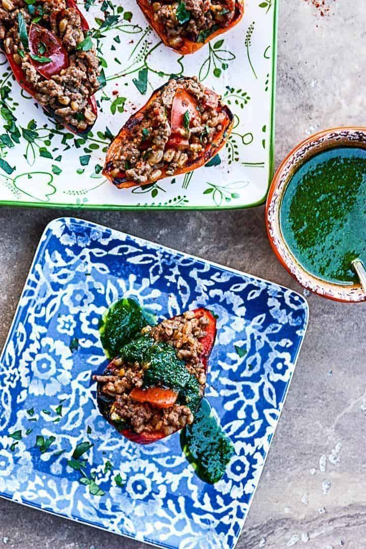 A close up of food on a table, with Farro and sauce