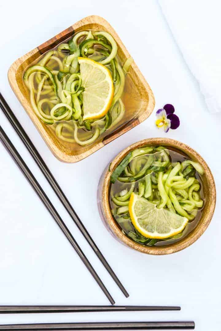 two servings of sunomono salad in wooden bowls