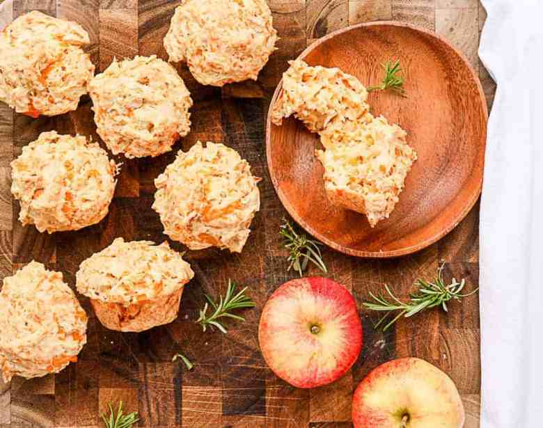 Muffins on a wooden table with apples