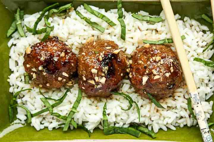 A close up of meatballs on rice