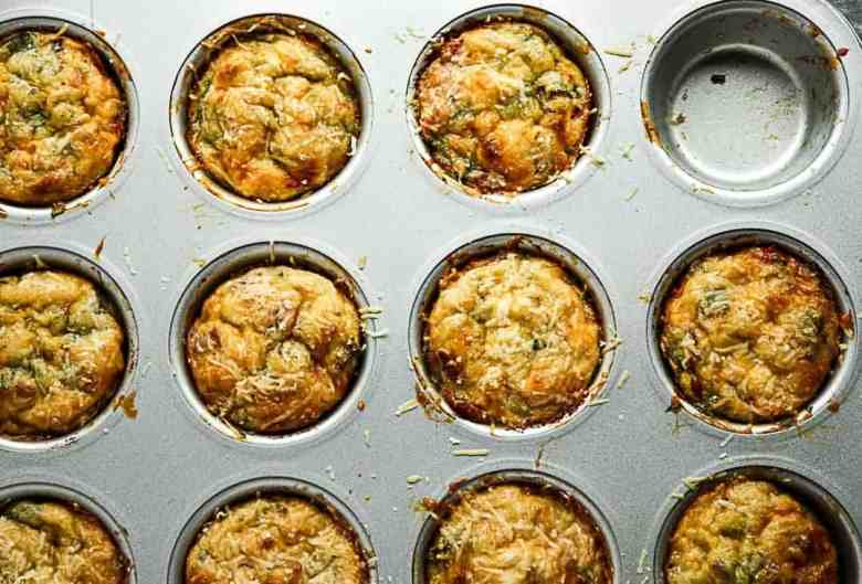 A muffin pan with Baked Bacon & Spinach Breakfast Egg Cups