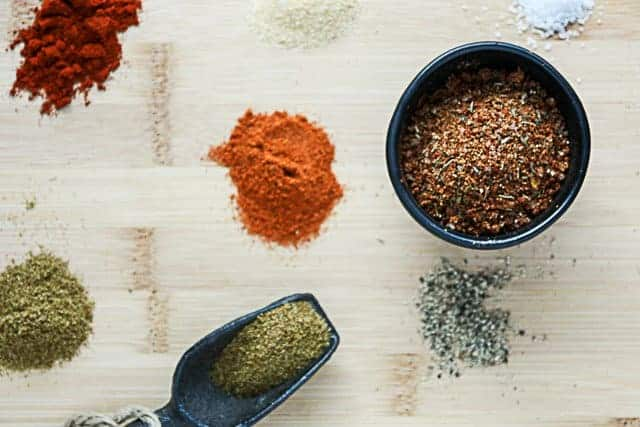 Spices and Seasoning mixture on a wooden cutting board