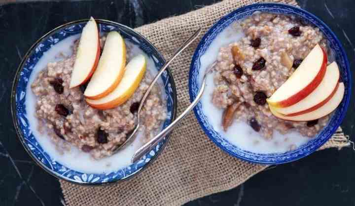 Two bowls of oatmeal with spoons