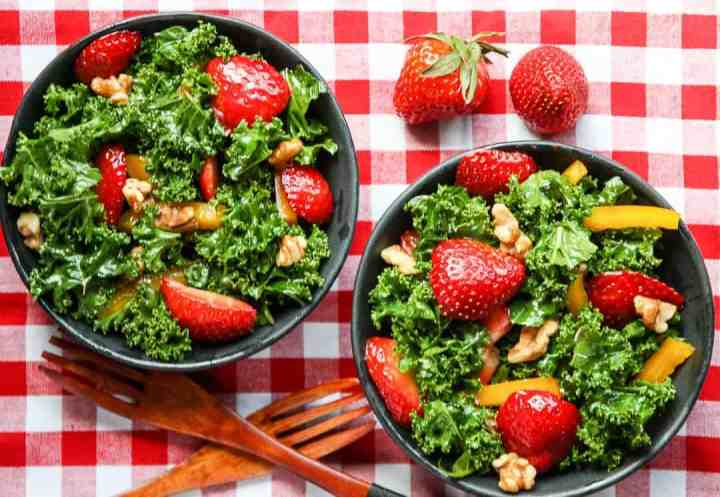 A bowl of salad, with Kale and Strawberry