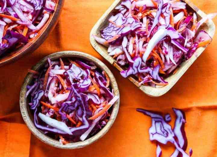 Two wooden bowls of coleslaw