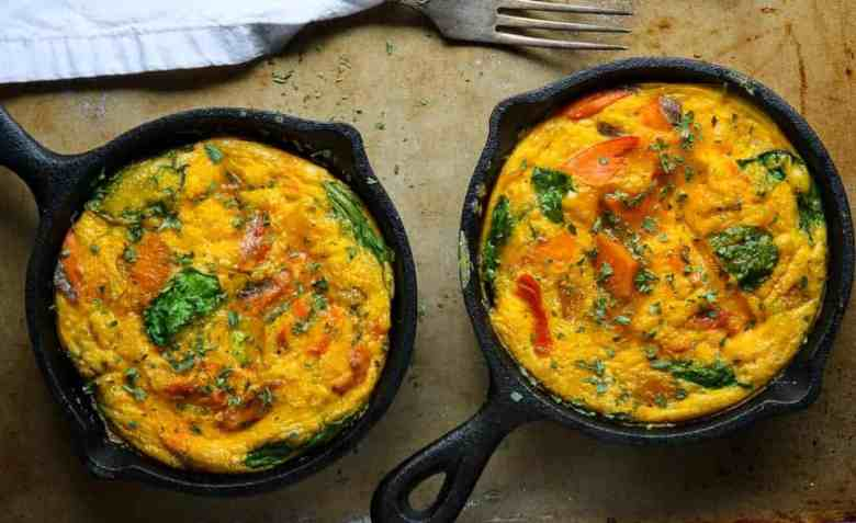 Two pans of cooked frittata sitting on top of a stove
