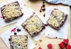 Squares of blueberry bars on a cutting board