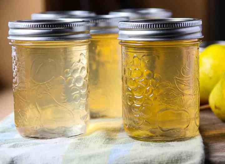 A close up of jars of jelly with lids