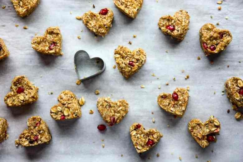 Oatmeal bites on a tray with a heart-shaped cookie cutter